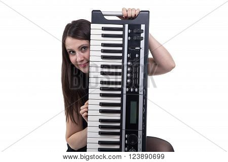 Smiling woman with synthesizer on white background