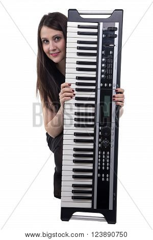 Funny sitting woman with synthesizer on white background