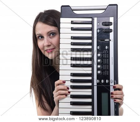 Smiling young woman with synthesizer on white background