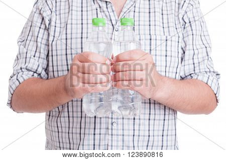 Man Holding Two Plastic Bottles Of Water