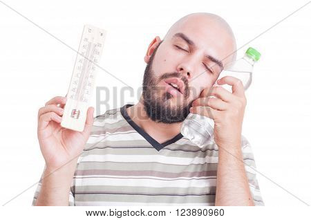 Summer heat and dehydration concept with man holding thermometer and cold water bottle