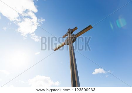 Christian cross with blue sky, copy space