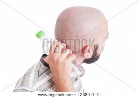 Man Cooling His Back Neck With Cold Water Bottle