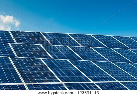 Solar panels on blue sky with copy space and text area