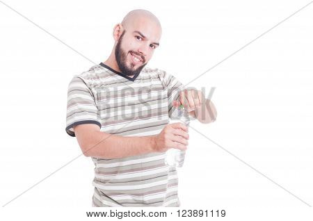 Smiling Man Opening A Bottle Of Cold Water