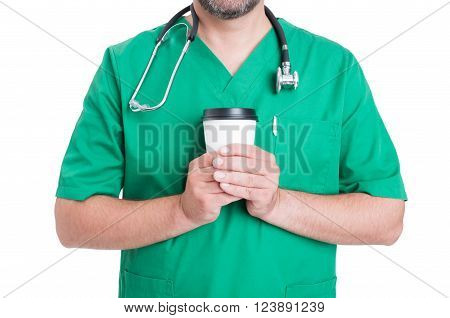 Doctor in coffee break concept with male medic holding a coffee to-go cup