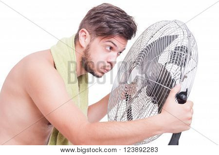 Summer Heat Concept With Naked Man Holding Blowing Cooler