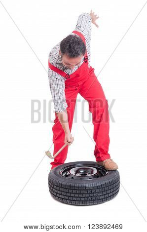 Angry Mechanic Changing Tire