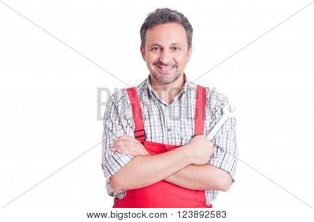 Confident Mechanic Holding Wrench With Arms Crossed