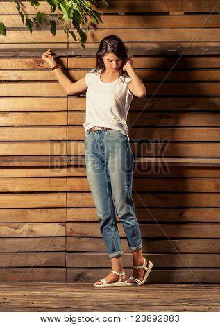 Female Model Posing On Wooden Background