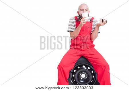 Young Mechanic Smelling Fresh Coffee From A Cup