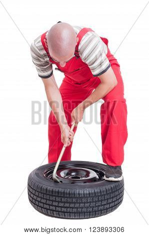 Hard-working Mechanic Changing Car Wheel Tire