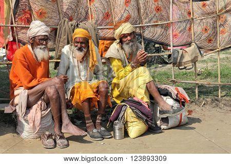 ALLAHABAD, INDIA - FEBRUARY 09, 2013: Three unidentified sadhu pilgrims (holy man) at the Maha Kumbh Mela Hindu religious festival