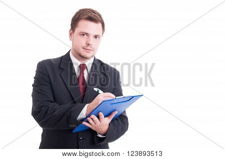 Busy And Confident Accountant Writing On Clipboard