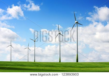 Landscape with wind turbines in a green field