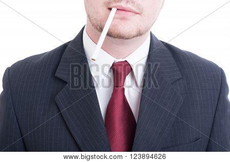 Businessman Holding An Unlit Cigarette Between Lips
