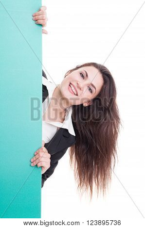 Business Woman Behing A Green Wall With Advertising Space