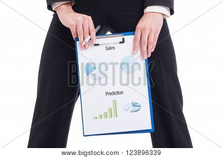 Young And Sexy Sales Woman Showing Financial Charts And Graphs