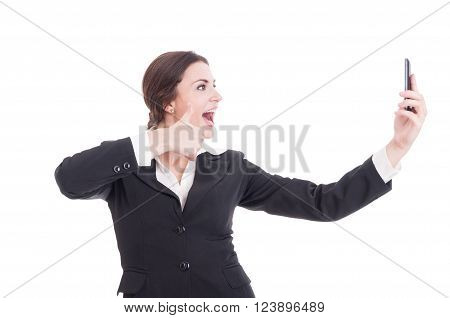 Young beautiful business woman taking a selfie showing like gesture isolated on white studio background