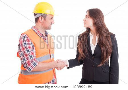 Builder constructor and business woman shaking hands as partnership and teamwork concept isolated on white background ** Note: Soft Focus at 100%, best at smaller sizes