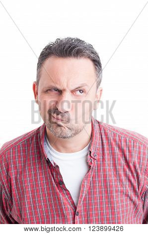 Potrait of a man wondering and thinking wearing casual checkered shirt isolated on white background