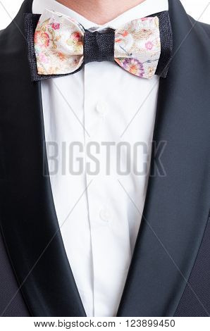 Elegant suit jacket and colored custom made bow tie. Formal modern and fashionable concept