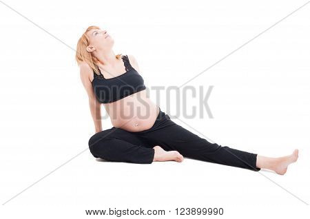 Beautiful Young Pregnant Woman Sitting Relaxed On The Floor
