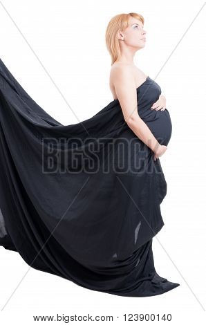Graceful concept of pregnant woman wearing black veil or textile isolated on white background