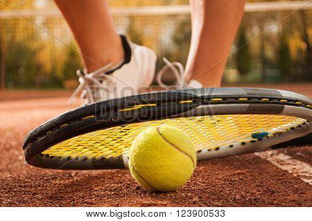Tennis Concept With Ball, Netting, Racket And Woman Feet