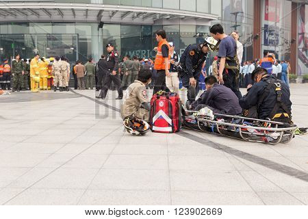 CHIANG MAI, THAILAND - MARCH 25: Paramedic practice to help people in disaster in mock disaster drill at Maya shopping center in Chiang Mai, Thailand on March 25, 2016.