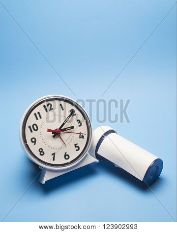 Alarm clock with a sleeping prescription bottle.
