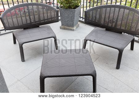 black wicker rattan chair and table at the balcony