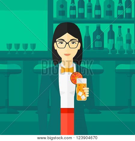 Woman holding glass of juice.