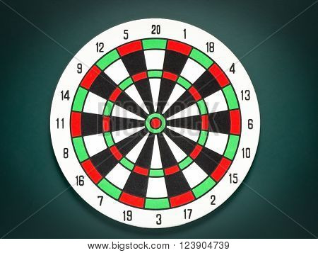Classic dart target board. Colorful of dartboard on black background.