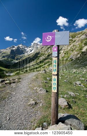 Hiking trail passage in National Park Les Ecrins France - signpost showing the routes