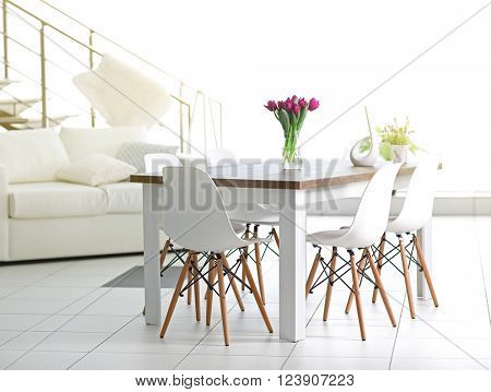 Beautiful comfortable modern interior with table and chairs