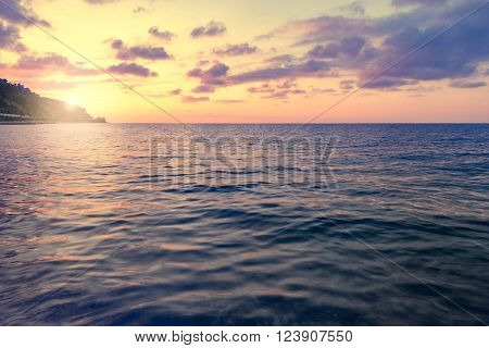 Calm surface of the sea at sunset time.