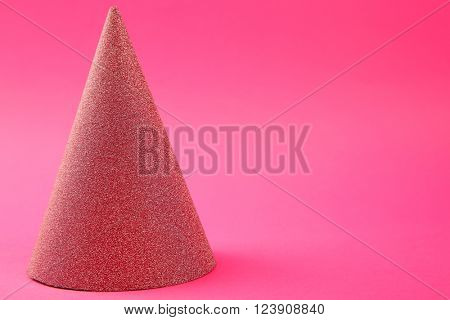 Birthday hat on pink background