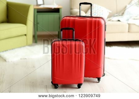 Large red polycarbonate suitcases, close up