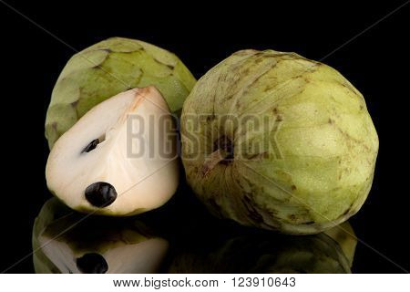 Custard apple also known as Bullocks or Bulls Heart.On black with reflection.