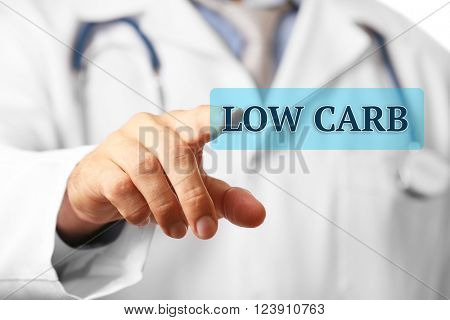 Doctor pointing on Low-Carb button close-up