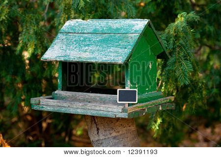 Large Birdhouse In A Forest And A Blackboard