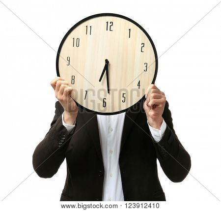Man in black suit covering his face with big clock on white background