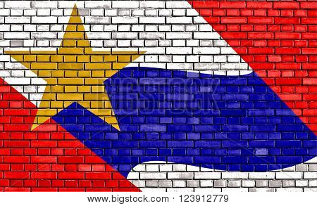 flag of Lafayette painted on brick wall