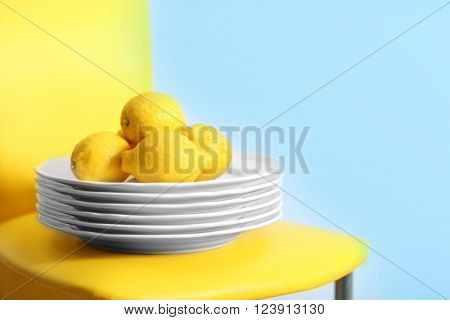 Plate of lemons on a chair, closeup