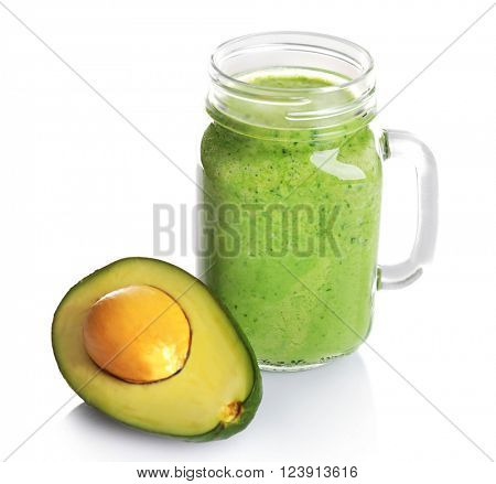 Jar of fresh avocado cocktail and avocado fruit isolated on white