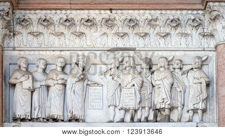 LUCCA, ITALY - JUNE 06, 2015: The right portal of the Cathedral of St Martin in Lucca. Lunette dedicated to the life of Saint Regulus, Lucca, Italy, on June 06, 2015