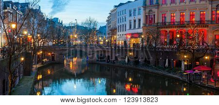 Ancient city center of Utrecht Netherlands features many buildings from the Early Middle Ages. The Oudegracht area - a canal following the Rhine river with shops restaurants and bars