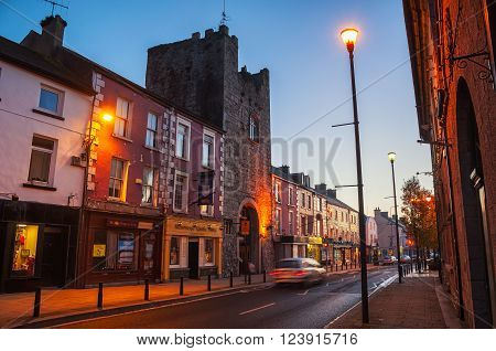 Main street of Cashel Ireland at night with bars and restaurants. Town hotel located in the old historical tower of the popular touristic city in Tipperary