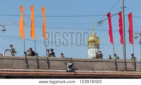 Moscow - 7 May 2015: Many soldiers and officers in stylized military uniform flow along the Great Moscow River bridge on the background of the bell tower of Ivan the Great in the rehearsal of the military parade May 7 2015 Moscow Russia